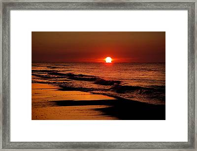 Sun Emerging From The Water Framed Print by Michael Thomas