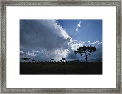 Sun Rays Break Through Clouds Framed Print by Roy Toft
