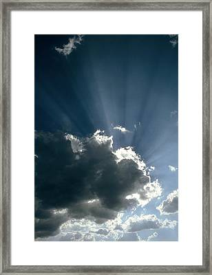 Sun Rays Shining From Behind A Cloud Framed Print by Tony Craddock