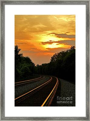 Sun Reflecting On Tracks Framed Print by Benanne Stiens