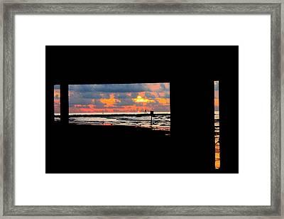 Sun Rise From Under The Pier Framed Print by Mark Longtin
