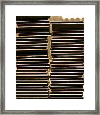 sun sets on the music CD Framed Print by Bill Owen