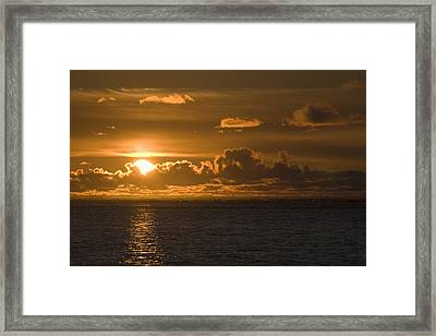 Sun Setting On The Ocean With The Framed Print by Michael Interisano