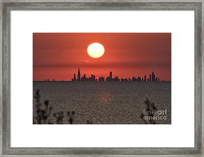 Sun Setting Over Chicago Framed Print by Christopher Purcell