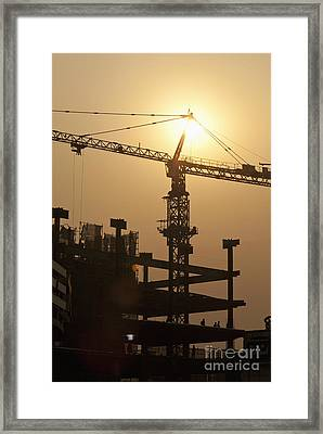Sun Shining Behind A Construction Crane Framed Print by Shannon Fagan