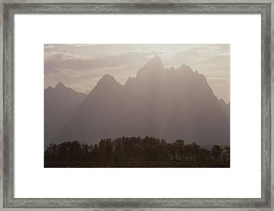 Sun Streams Over The Grand Teton, Grand Framed Print by Raymond Gehman