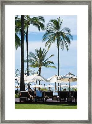 Sunbath Near The Pool Framed Print by Atiketta Sangasaeng