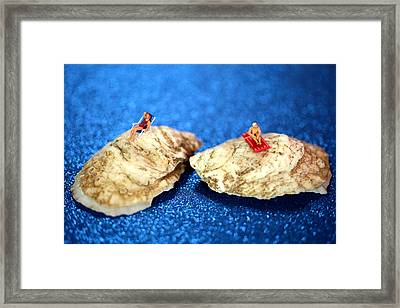Sunbathers On Shells Framed Print by Paul Ge