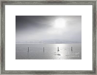 Sunlight Illuminating An Icy Landscape Framed Print