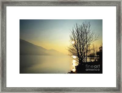 Sunlight On An Alpine Lake Framed Print