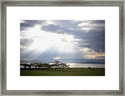 Sunlight Shines Down Through The Clouds Framed Print