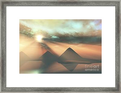 Sunrays Shine Down On Three Pyramids Framed Print by Corey Ford