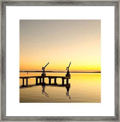 Sunrise At The Boat Dock Framed Print by Chris Thaxter