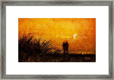 Sunrise Couple Framed Print