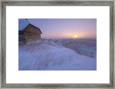 Sunrise On Abandoned, Snow-covered Framed Print by Dan Jurak