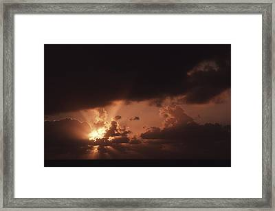 Sunset And Clouds Over Water Framed Print by Ira Block
