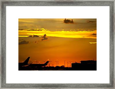 Sunset At Kci Framed Print by Lisa Plymell