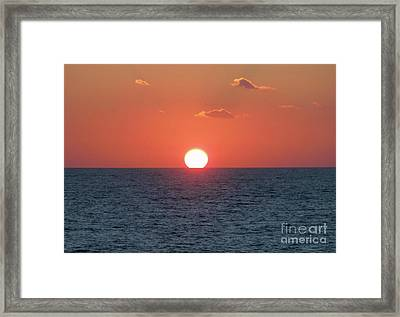Sunset At Sea Framed Print by Marilyn West