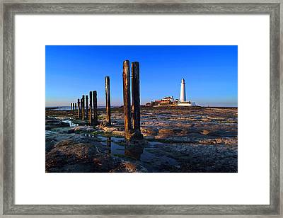 Sunset At St. Mary's Lighthouse Framed Print by Michael Oakes