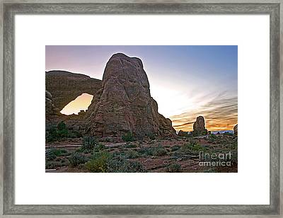 Sunset At Turret Arch Framed Print by Robert Bales