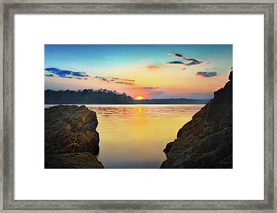 Sunset Between The Rocky Shore Framed Print
