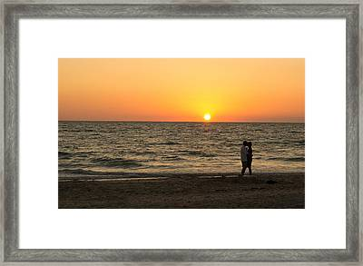 Sunset Embrace Framed Print