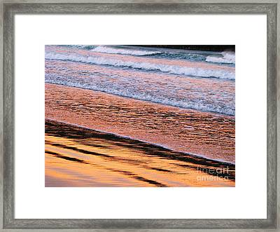 Sunset In Sand And Waves Framed Print by Michele Penner