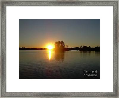 Sunset Juggler Lake Island Framed Print