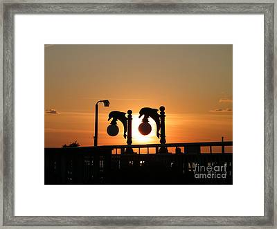 Sunset Lamps R Framed Print by Laurence Oliver