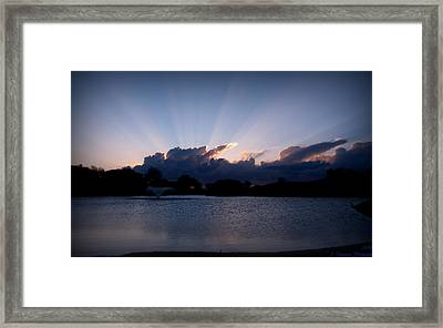 Sunset Light Rays Over The Pond Framed Print by Aaron Burrows