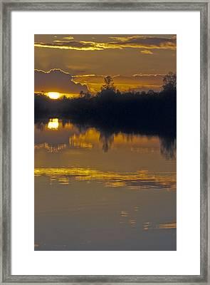 Sunset On A Lake Framed Print by Patrick Kessler