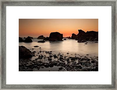 Sunset On A Rock Framed Print by Keith Kapple