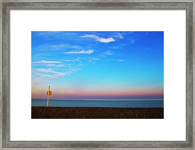 Sunset On Empty Beach With Lifebouy On Post Framed Print by Image by Catherine MacBride