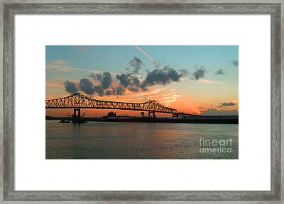 Sunset On The Mississippi  Framed Print by Lydia Holly