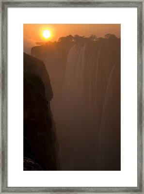 Sunset Over Cascading Victoria Falls Framed Print by Ralph Lee Hopkins