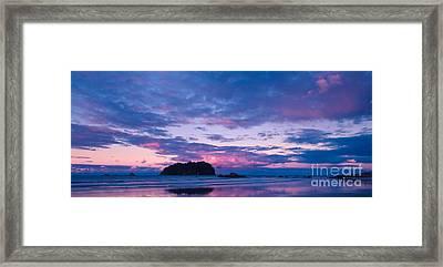 Sunset Over Motuotau Island Framed Print by John Buxton