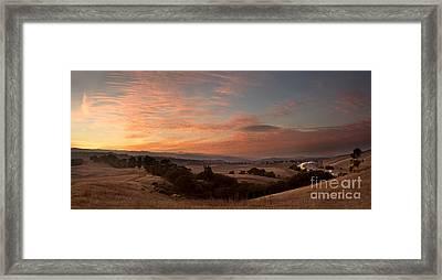 Sunset Over Separate Worlds Framed Print