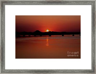 Sunset Over The Big Dam Bridge Framed Print by Joe Finney