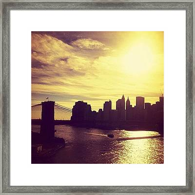 Sunset Over The New York City Skyline And The Brooklyn Bridge Framed Print by Vivienne Gucwa