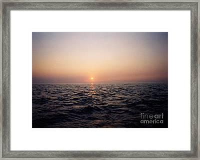 Sunset Over The Ocean Framed Print by Thomas Luca