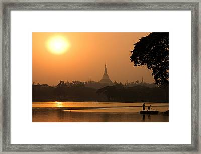 Sunset Over The Shwedagon Pagoda Framed Print by Austin Bush