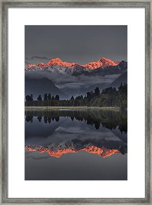 Sunset Reflection Of Lake Matheson Framed Print by Colin Monteath