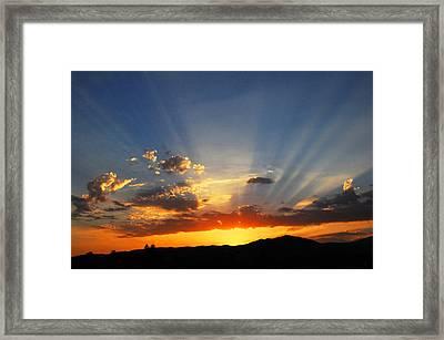Sunset Sun Rays Framed Print by Lynn Bauer