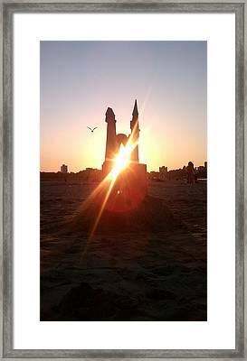 Framed Print featuring the photograph Sunset Sunlit Sandcastle With Flying Bird On A Chicago Beach by M Zimmerman