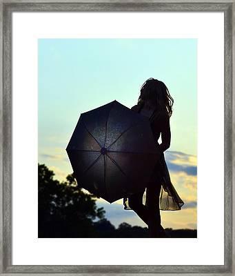 Sunset Walker Framed Print by Kurt Bonnell