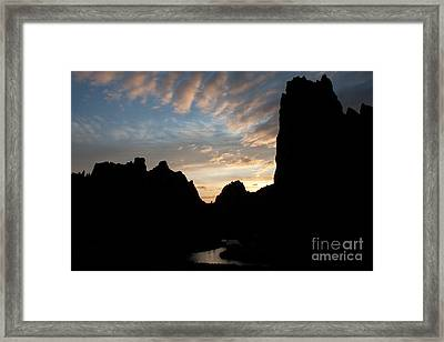Sunset With Rugged Cliffs In Silhouette Framed Print by Karen Lee Ensley