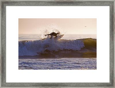 Surfer At Dusk Riding A Wave At Rincon Framed Print by Rich Reid