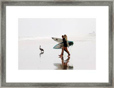 Framed Print featuring the photograph Surfers And A Pelican by Alice Gipson
