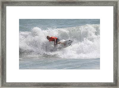 Surfing In Cocoa Beach Framed Print by Jeanne Andrews