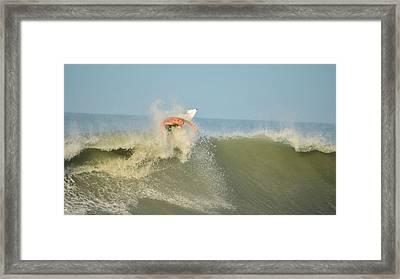 Surfing Rocks Framed Print by Lynda Dawson-Youngclaus